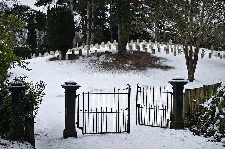 Snow covered graves, ?Netley Military Cemetery, ?Netley Abbey, Southampton, Hampshire. 10/01/10