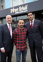 Pictured: Leon Britton (C) and MP Geraint Davies (L)Friday 17 February 2017<br />Re: Swansea footballer Leon Britton at the official opening of German Doner Kebab restaurant in the Uplands area of Swansea, Wales, UK.