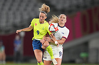 TOKYO, JAPAN - JULY 20: Kosovare Asllani #9 of Sweden and Lindsey Horan #9 of USA battle for a ball during a game between Sweden and USWNT at Tokyo Stadium on July 20, 2021 in Tokyo, Japan.