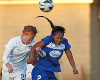 Washington Spirit midfielder Victoria Huster (Tori Huster) (23) and Boston Breakers forward Sydney Leroux (2) battle for head ball.  In a National Women's Soccer League Elite (NWSL) match, the Boston Breakers (blue) tied the Washington Spirit (white), 1-1, at Dilboy Stadium on April 14, 2012.