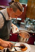 Chef Dominique le Stanc serves Provençal speciality beef daube at his restaurant La Merenda, Nice, France, 16 October 2013.