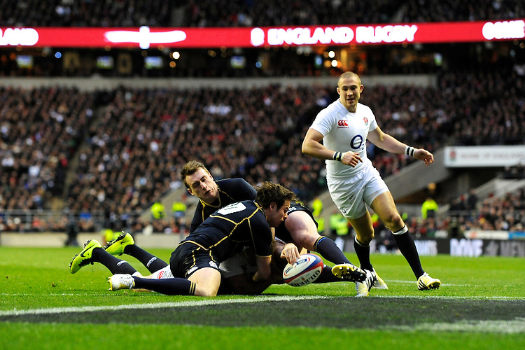 Chris Ashton of England scores a try during the RBS 6 Nations match between England and Scotland at Twickenham on Saturday 02 February 2013 (Photo by Rob Munro)