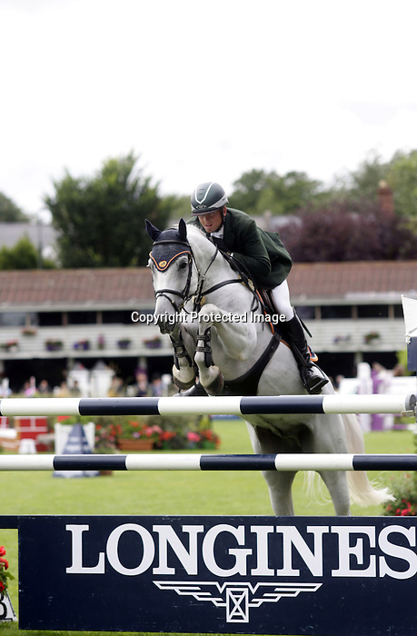 August 09, 2009: Trevor Breen (IRL) aboard Womack competing in the Grand Prix event. Longines International Grand Prix. Failte Ireland Horse Show. The RDS, Dublin, Ireland.