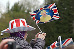 Merthyr Tydfil - UK - 26th April 2012 : Young royals fan with flag and hat during the Queen and the Duke of Edinburgh's visit to Cyfarthfa Castle museum and art gallery in Merthyr Tydfil this afternoon.  The Queen and Prince Philip are visiting towns and cities all over the United Kingdom to mark the Diamond Jubilee year.