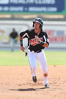 Alex Burg (4) of the High Desert Mavericks runs the bases during a game against the Bakersfield Blaze at Mavericks Stadium on May 18, 2015 in Adelanto, California. High Desert defeated Bakersfield, 7-6. (Larry Goren/Four Seam Images)
