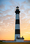 Cape Hatteras National Seashore, North Carolina: Sunrise colored clouds at Bodie Island lighthouse (1872) on North Carolina's Outer Banks