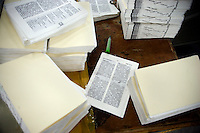 """Pages of Chinese-language Bibles sit on a binding table in the Amity Printing Company's new printing facility in Nanjing, China....On May 18, 2008, the Amity Printing Company in Nanjing, Jiangsu Province, China, inaugurated its new printing facility in southern Nanjing.  The facility doubles the printing capacity of the company, now up to 12 million Bibles produced in a year, making Amity Printing Company the largest producer of Bibles in the world.  The company, in cooperation with the international organization the United Bible Societies, produces Bibles for both domestic Chinese use and international distribution.  The company's Bibles are printed in Chinese and many other languages.  Within China, the Bibles are distributed both to registered and unregistered Christians who worship in illegal """"house churches."""""""