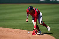 Boston Red Sox Enrique Hernández (5) fields a ground ball during a Major League Spring Training game against the Atlanta Braves on March 7, 2021 at CoolToday Park in North Port, Florida.  (Mike Janes/Four Seam Images)