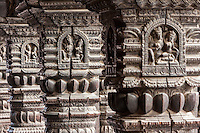 Nepal, Patan.  Hindu Temple Columns Showing Carvings Depicting Shiva and Parvati.