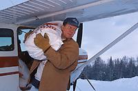 Unloading Dog Food off Plane Skwentna Chkpt Iditarod 99 Anchorage Monty Mabry