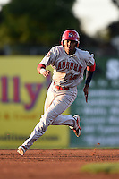 Auburn Doubledays third baseman Diomedes Eusebio (18) running the bases during a game against the Batavia Muckdogs on August 27, 2014 at Dwyer Stadium in Batavia, New York.  Auburn defeated Batavia 6-4.  (Mike Janes/Four Seam Images)