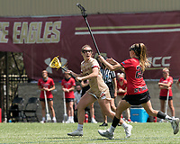 NEWTON, MA - MAY 14: Cassidy Weeks #12 of Boston College looks to pass as Maggie Reynolds #28 of Fairfield University defends during NCAA Division I Women's Lacrosse Tournament first round game between Fairfield University and Boston College at Newton Campus Lacrosse Field on May 14, 2021 in Newton, Massachusetts.