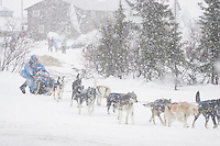 Dee Dee Jonrow leaves the Kaltag checkpoint during a brief snow squall.  2005 Iditarod Trail Sled Dog Race.