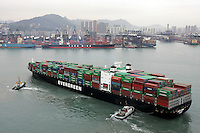 A container ship arrives at the port of Hong Kong, China. Asian shipping shares slumped Tuesday, reflecting a decrease in global demand for commodities and an industry suffering from excess capacity due to the global downturn in trade..07 Apr 2009
