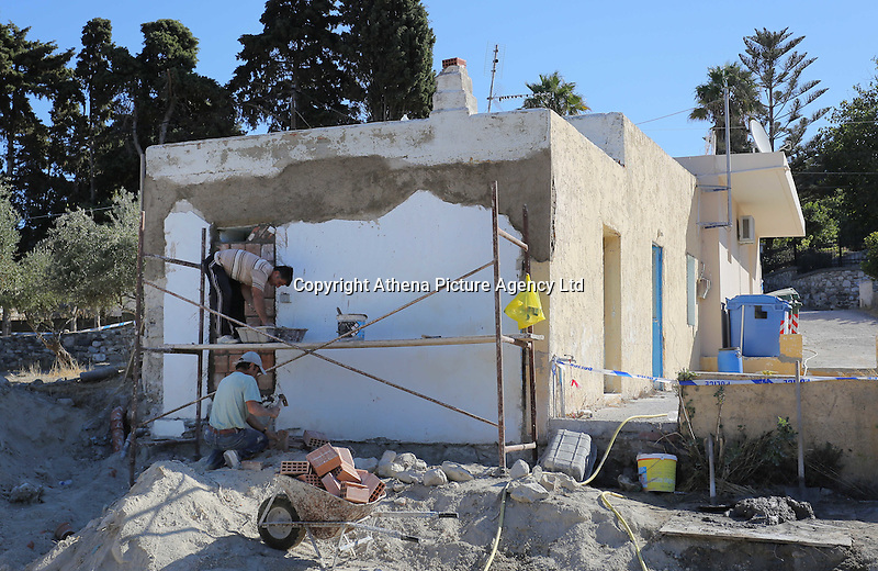 Pictured: Builders reconstruct part of the house -where Ben Needham disappeared from- which had to be demolished for the investigation in Kos, Greece. Friday 14 October 2016<br />Re: Police teams led by South Yorkshire Police are searching for missing toddler Ben Needham on the Greek island of Kos.<br />Ben, from Sheffield, was 21 months old when he disappeared on 24 July 1991 during a family holiday.<br />Digging has begun at a new site after a fresh line of inquiry suggested he could have been crushed by a digger.