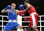 Wales Sean McGoldrick in action against South Africa's Ayabonga Sonjica<br /> <br /> Photographer Ian Cook/Sportingwales<br /> <br /> 20th Commonwealth Games -Boxing -  Day 7 - Wednesday 30th July 2014 - Glasgow - UK