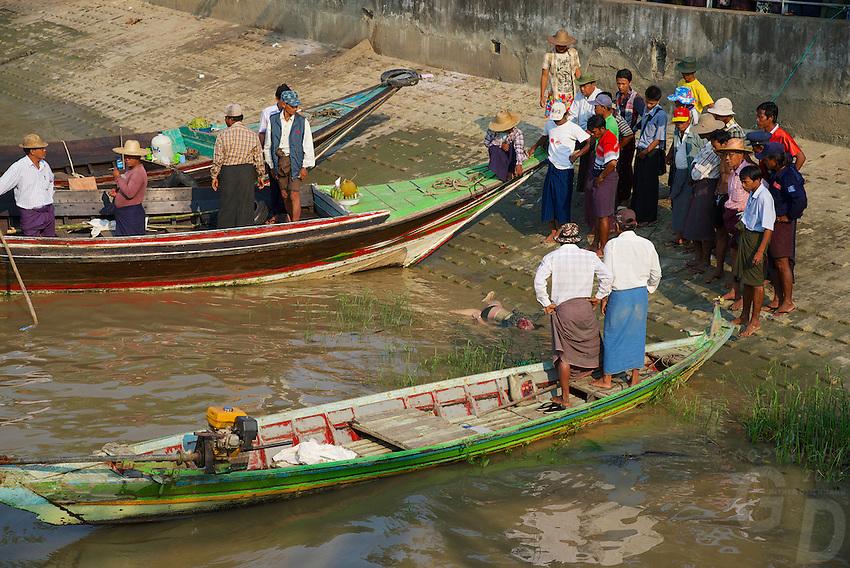 A dead Body floating in the Yangon River, Myanmar, Burma
