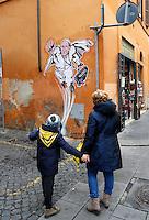 """Un disegno di Papa Francesco raffigurato come Superman, realizzato dall'artista di strada Maupal (Maurizio Pallotta) e affisso da lui stesso sulla parete di un palazzo del rione Borgo, nei pressi della Citta' del Vaticano, a Roma, 29 gennaio 2014.<br /> People look at a street art mural by Italian street artist Maupal (Maurizio Pallotta) depicting Pope Francis as Superman, and holding a bag reading """"Values"""" on a wall of the Borgo district near the Vatican, in Rome, 29 January 2014.<br /> UPDATE IMAGES PRESS/Riccardo De Luca<br /> <br /> STRICTLY ONLY FOR EDITORIAL USE"""