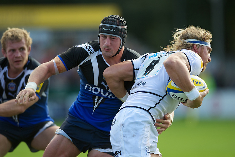Ben Skirving of Bath Rugby tackles Andy Powell of Sale Sharks during the Aviva Premiership match between Bath Rugby and Sale Sharks at the Recreation Ground on Saturday 29th September 2012 (Photo by Rob Munro)