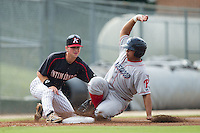 Willians Astudillo (11) of the Lakewood BlueClaws slides into third base ahead of the tag by Tyler Shryock (2) of the Kannapolis Intimidators at CMC-NorthEast Stadium on July 20, 2014 in Kannapolis, North Carolina.  The Intimidators defeated the BlueClaws 7-6. (Brian Westerholt/Four Seam Images)