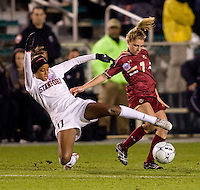 Lindsay Taylor (17) of Stanford tackles the ball away from Amy Caldwell (7) of Boston College during the second game of the NCAA Women's College Cup at WakeMed Soccer Park in Cary, NC.  Stanford defeated Boston College, 2-0.