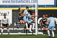 Brittany Bock (11) of the Los Angeles Sol goes up for a header against Natasha Kai (6) and Anita Asante (5) of Sky Blue FC. The Los Angeles Sol defeated Sky Blue FC 2-0 during a Women's Professional Soccer match at TD Bank Ballpark in Bridgewater, NJ, on April 5, 2009. Photo by Howard C. Smith/isiphotos.com