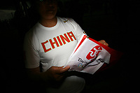 CHINA. Beijing. A woman in a stadium during the Beijing 2008 Summer Olympics. 2008