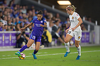 Orlando, FL - Saturday March 24, 2018: Orlando Pride defender Poliana Barbosa Medeiros (19) cuts in on Utah Royals forward Elise Thorsnes (20) during a regular season National Women's Soccer League (NWSL) match between the Orlando Pride and the Utah Royals FC at Orlando City Stadium. The game ended in a 1-1 draw.