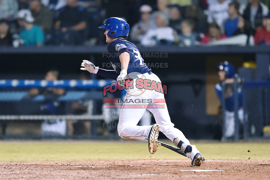 Asheville Tourists second baseman Forrest Wall (7) swings at a pitch during game 3 of the South Atlantic League Championship Series between the Asheville Tourists and the Hickory Crawdads on September 17, 2015 in Asheville, North Carolina. The Crawdads defeated the Tourists 5-1 to win the championship. (Tony Farlow/Four Seam Images)