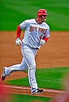 13 April 2009: Washington Nationals' outfielder Adam Dunn rounds third after hitting his first home run in a Nationals uniform against the Philadelphia Phillies during the Nats' Home Opener at Nationals Park in Washington, DC. The Nats fell short in their 9th inning rally, losing 9-8, and marking their 7th consecutive loss of the 2009 season. Mandatory Credit: Ed Wolfstein Photo