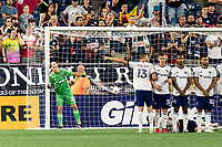 FOXBOROUGH, MA - AUGUST 18: Jon Kempin #21 of D.C. United sets the wall during a game between D.C. United and New England Revolution at Gillette Stadium on August 18, 2021 in Foxborough, Massachusetts.