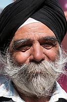 India, Dehradun.  Elderly Sikh Businessman.