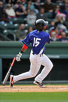 Right fielder Joseph Monge (15) of the Greenville Drive bats in a game against the Asheville Tourists on Sunday, April 10, 2016, at Fluor Field at the West End in Greenville, South Carolina. Greenville won 7-4. (Tom Priddy/Four Seam Images)