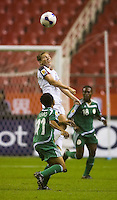 USA midfielder (17) Lori Chalupny rises above Nigeria forward (11) Chi-Chi Igbo during their Group B first round game at Hongkou Stadium in Shanghai, China on September 18, 2007. The USA defeated Nigeria, 1-0.