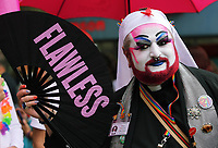A man with Flawless fan joins thousands of people in this year's Pride Parade in the centre of Cardiff, Wales, UK. Sayurday 26 August 2017