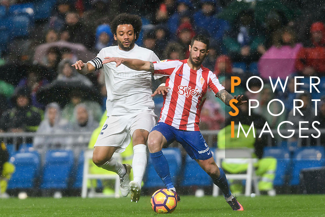 """Marcelo Vieira Da Silva (l) of Real Madrid battles for the ball with Manuel Castellano """"Lillo"""" of Real Sporting de Gijon during the La Liga match between Real Madrid and Real Sporting de Gijon at the Santiago Bernabeu Stadium on 26 November 2016 in Madrid, Spain. Photo by Diego Gonzalez Souto / Power Sport Images"""