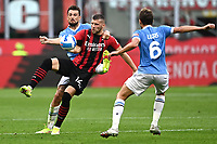 Francesco Acerbi of SS Lazio , Ante Rebic of AC Milan , Lucas Leiva of SS Lazio compete for the ball during the Serie A 2021/2022 football match between AC Milan and SS Lazio at Giuseppe Meazza stadium in Milano (Italy), August 29th, 2021. Photo Image Sport / Insidefoto