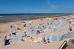 Belgium, West Vlaanderen, De Panne: View along North Sea beach in Summer