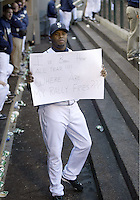 """04 October 2009: Seattle Mariners designated hitter Ken Griffey Jr holds up a sign for the TV camera saying """"I've been here all year!!! Where are my Rally Fries??? during the game against Texas. Seattle won 4-3 over the Texas Rangers at Safeco Field in Seattle, Washington."""