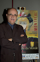 Montreal World Film Festival's President & founder ; <br /> Serge Losique,pose for photographers beside a poster of this year Festival , August 6th, 2001 in Montreal, CANADA.<br /> <br /> This year mark the 25th anniversary of the Montreal World Film Festival<br /> <br /> <br />  File Photo Agence Quebec Presse - Pierre Roussel