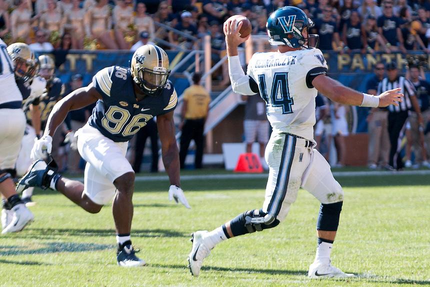 Pitt defensive lineman Allen Edwards rushes the quarterback. The Pitt Panthers defeated the Villanova Wildcats 28-7 at Heinz Field, Pittsburgh, Pennsylvania on September 3, 2016.
