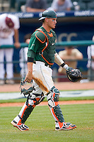 Yasmani Grandal #24 of the Miami Hurricanes walks out to the mound at the 2010 ACC Baseball Tournament at NewBridge Bank Park May 27, 2010, in Greensboro, North Carolina.  The Eagles defeated the Hurricanes 12-10 in 10 innings.  Photo by Brian Westerholt / Four Seam Images