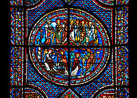 Medieval stained glass Window of the Gothic Cathedral of Chartres, France - dedicated to the Life of St Mary Magdalen. Central panel - bottom left - Mary meets the angel at Christ's empty tomb (the Quem quaeritis), bottom right - The Noli me tangere, top left - Mary as the Apostola Apostolorum , top right - The Apostles receiving Mary's news . A UNESCO World Heritage Site.