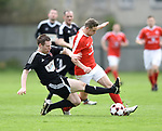 X of Janesboro in action against Daithi O Connell of Newmarket Celtic during their Munster Junior Cup semi-final at Limerick. Photograph by John Kelly.