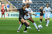BRIDGEVIEW, IL - JULY 18: Tatumn Milazzo #23 of the Chicago Red Stars kicks the ball during a game between OL Reign and Chicago Red Stars at SeatGeek Stadium on July 18, 2021 in Bridgeview, Illinois.
