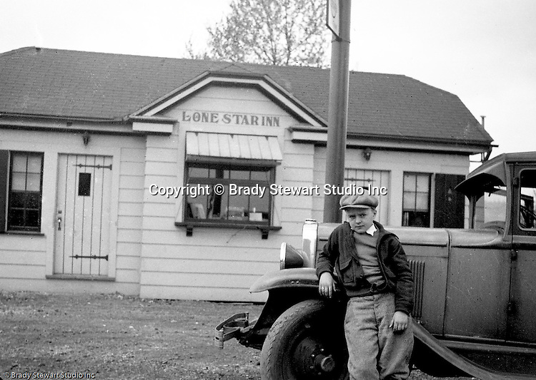 Markleysburg PA:  Stewart family taking a break off Route 40 on the way home from a vacation at Youghiogheny Lake. View of Brady Stewart Jr in front of the Lone Star Inn which is still operating off Route 40.  Stewart's traveling in a 1928 Chevrolet AB National Coach
