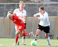 Lisa De Vanna #11 of the Washington Freedom loses the ball to Nikki Krzysik #15 and Jennifer Buczkowski #4 of the Philadelphia Independence during a WPS pre season match at the Maryland Soccerplex on March 27 2010 in Boyds, Maryland. The game ended in a 0-0 tie.