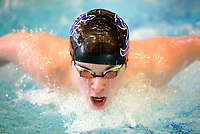 Fayetteville's Edward McKinnon competes Saturday, Feb. 13, 2021, in the 100-yard butterfly during the Class 6A-West Conference Swim Championships at the Jones Center in Springdale. Visit nwaonline.com/210214Daily/ for today's photo gallery. <br /> (NWA Democrat-Gazette/Andy Shupe)