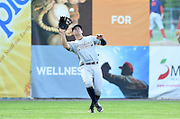 Staten Island Yankees outfielder Nathan Mikolas (30) catches a fly ball during a game against the Batavia Muckdogs on August 6, 2014 at Dwyer Stadium in Batavia, New York.  Batavia defeated Staten Island 5-3.  (Mike Janes/Four Seam Images)
