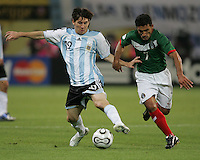 Argentinian forward (19) Lionel Messi pushes off from Mexican midfielder (7) Zinha.  Argentina defeated Mexico, 2-1, in overtime in their FIFA World Cup round of 16 match at Zentralstadion in Leipzig, Germany, June 24, 2006.